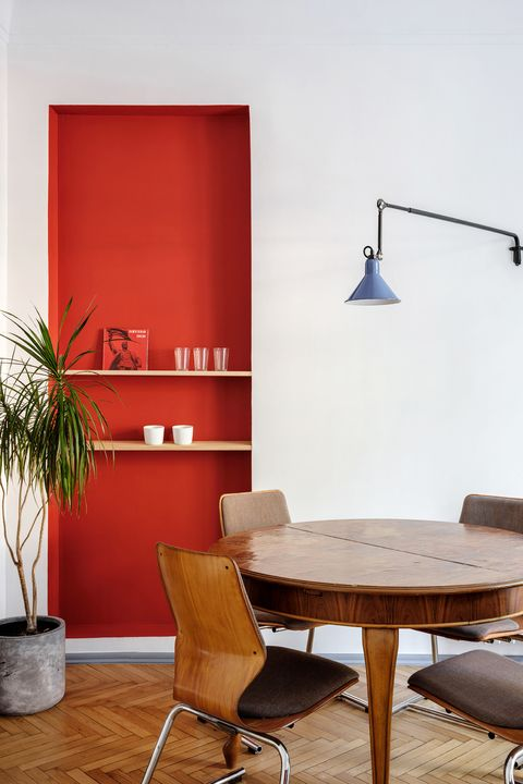 minimalist dining nook with red statement wall