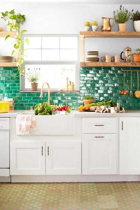 kitchen with green tile backsplash