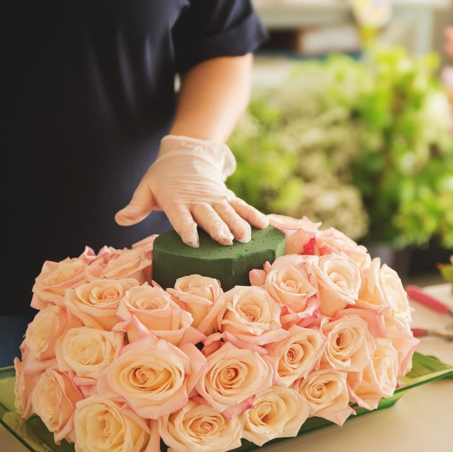 female florist using floral foam