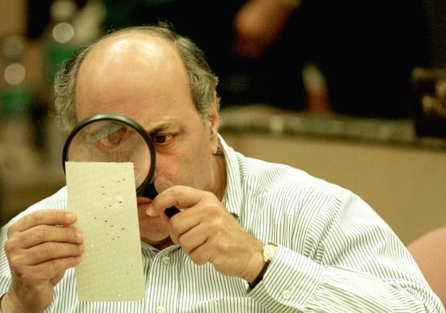 382382 03 file photo judge robert rosenberg of the broward county canvassing board uses a magnifying glass to examine a dimpled chad on a punch card ballot november 24, 2000 during a vote recount in fort lauderdale, florida on may 4, 2001 the florida state legislature overwhelmingly passed a voting reform act designed to eliminate the controversial punch card ballots which were the focal point of recount efforts in the 2000 presidential election photo by robert kingnewsmakers