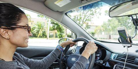 florida, miami beach, female uber driver using gps