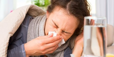Sick person blowing nose