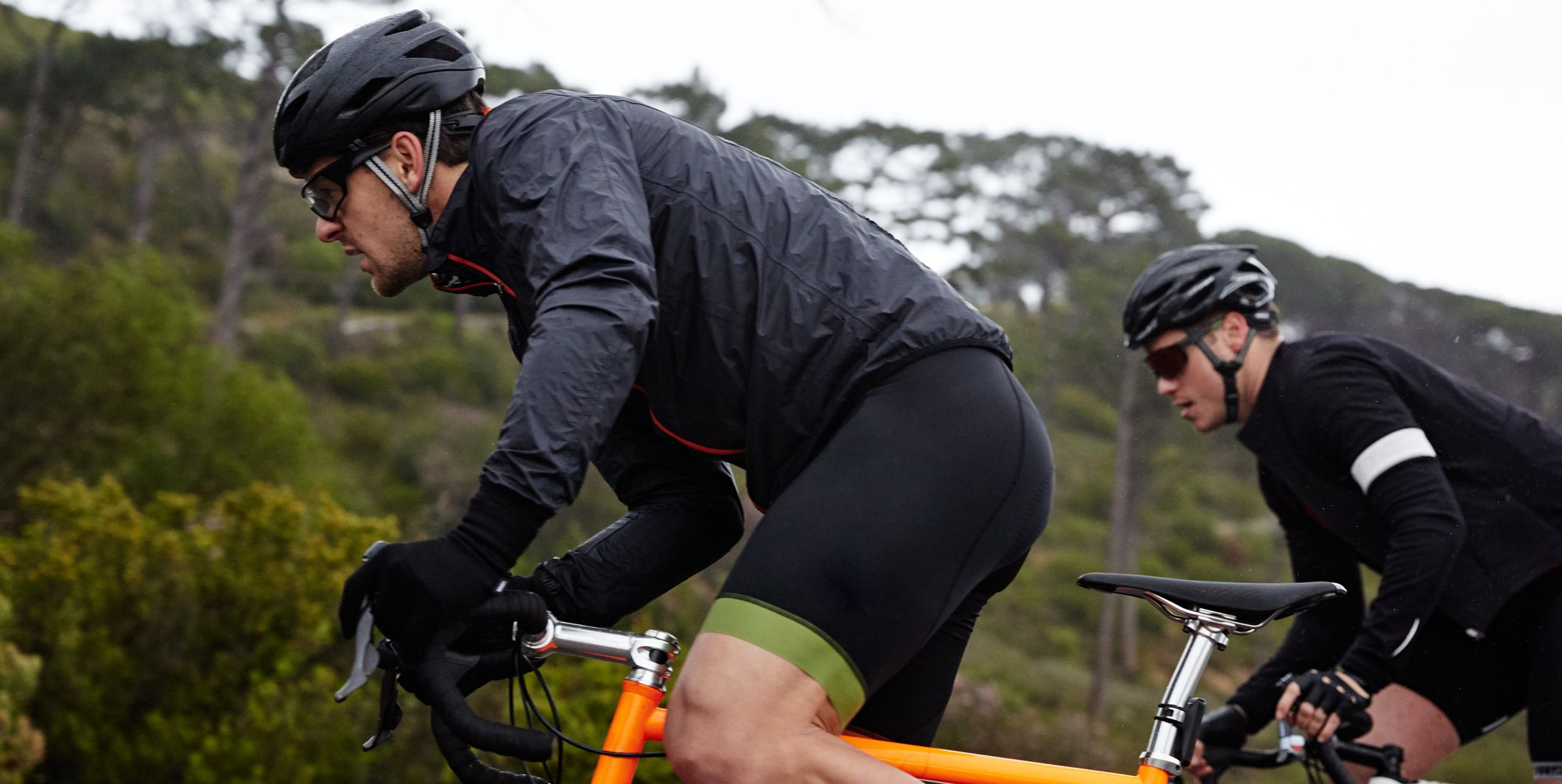 Focused, determined male cyclist cycling uphill