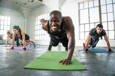 Focused determined powerful strong fitness workout push ups gritting teeth