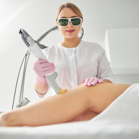 focused doctor carrying out a cosmetic procedure