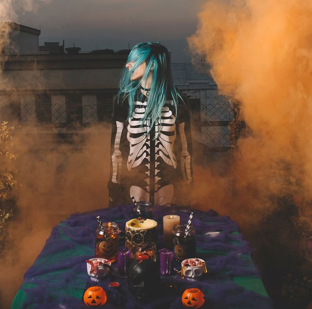 girl in skeleton costume at a foggy halloween party