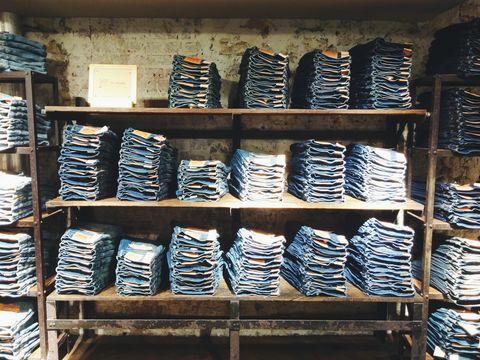 Folded Jeans Kept On Shelves In Shop