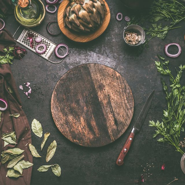 food background with empty circle wooden cutting board