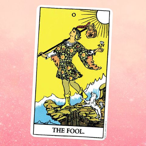 the tarot card the fool, showing a person in a patterned tunic standing on a cliff, holidng a flower and a bag, the sun shining on them