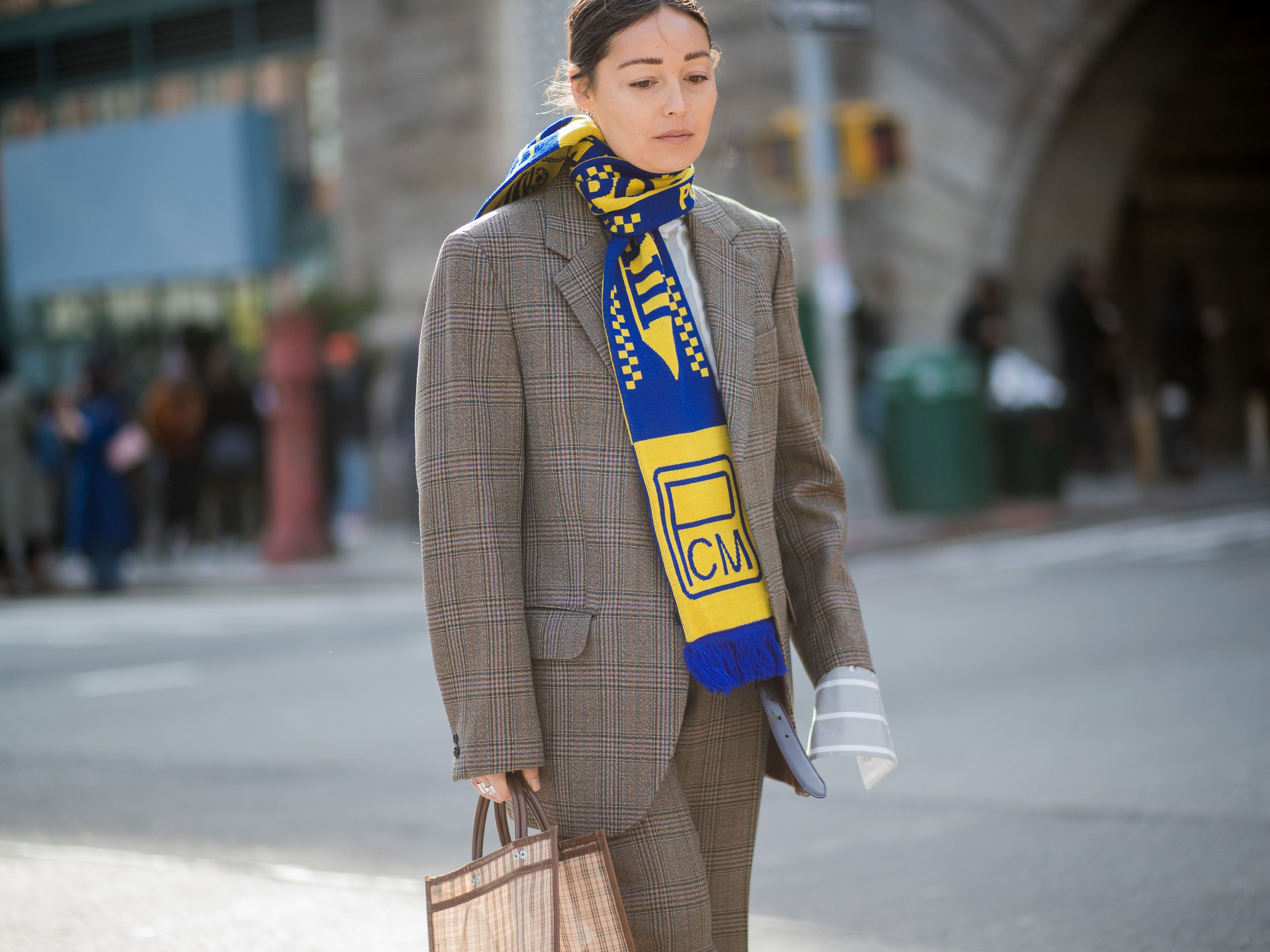 Rachael Wang wearing a football scarf during NYFW