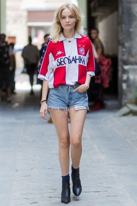 A guest wearing a football shirt during Men's Fashion Week in Paris