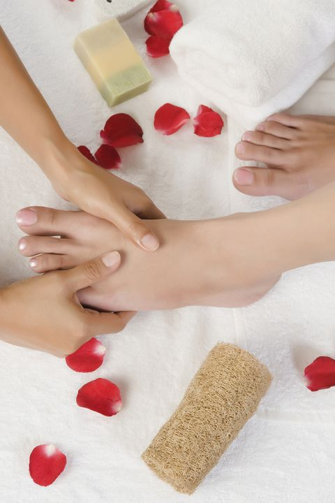 Woman receiving pedicure treatment at health spa