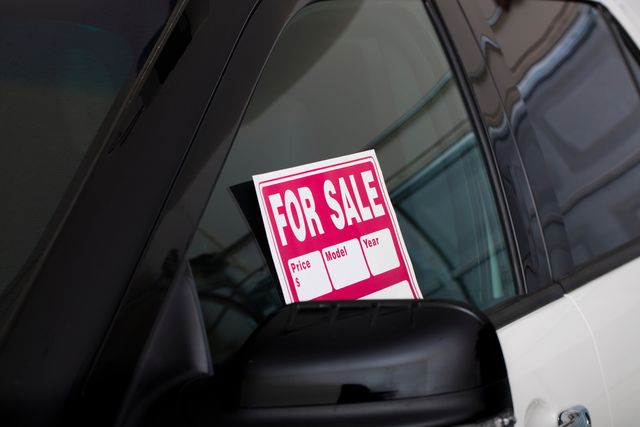 for sale sign in car