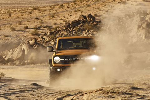 ford bronco driving through desert