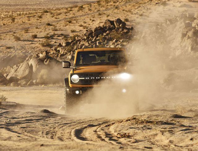 ford bronco driving through desert