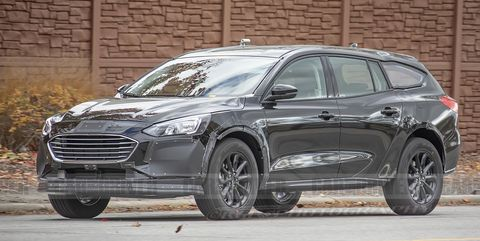 Next Ford Fusion Takes Shape as a Subaru Outback–Style Lifted Wagon