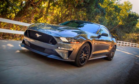 the ford mustang gt rumbles down the road with it's naturally aspirated v 8