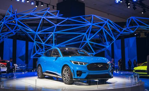 Land vehicle, Vehicle, Car, Auto show, Automotive design, Mid-size car, Electric blue, Sports car, Ford, Full-size car,