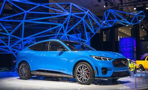 land vehicle, vehicle, car, auto show, automotive design, mid size car, sports car, electric blue, automotive wheel system, rim,