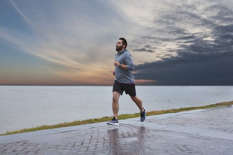 runner running by water wearing garmin forerunner 245 music