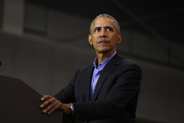 former president obama and former attorney general eric holder campaigns with michigan democrats