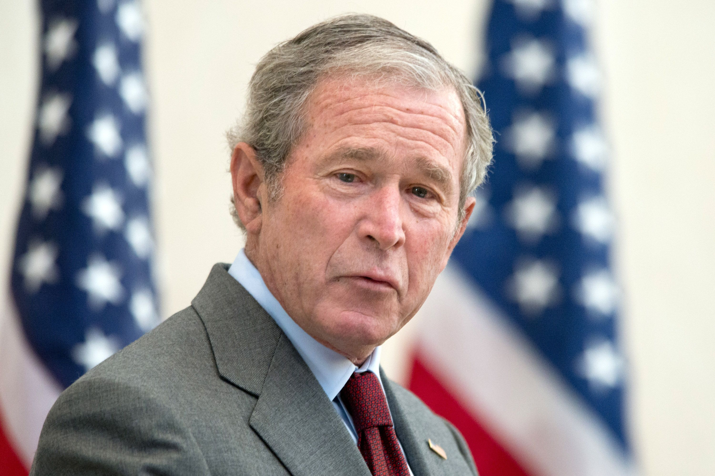 George W Bush Brings Pizza To Employees Who Are Working Hard For