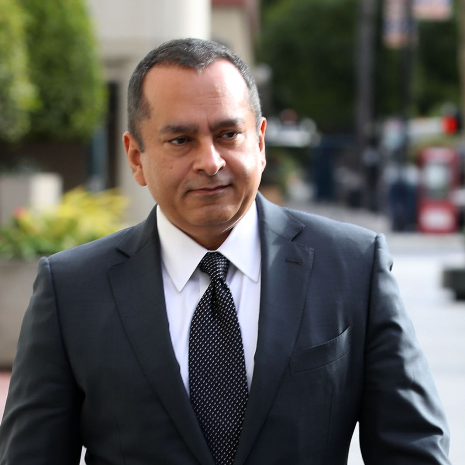 Former Theranos COO Ramesh Balwani leaves the courthouse on January 14, 2019.