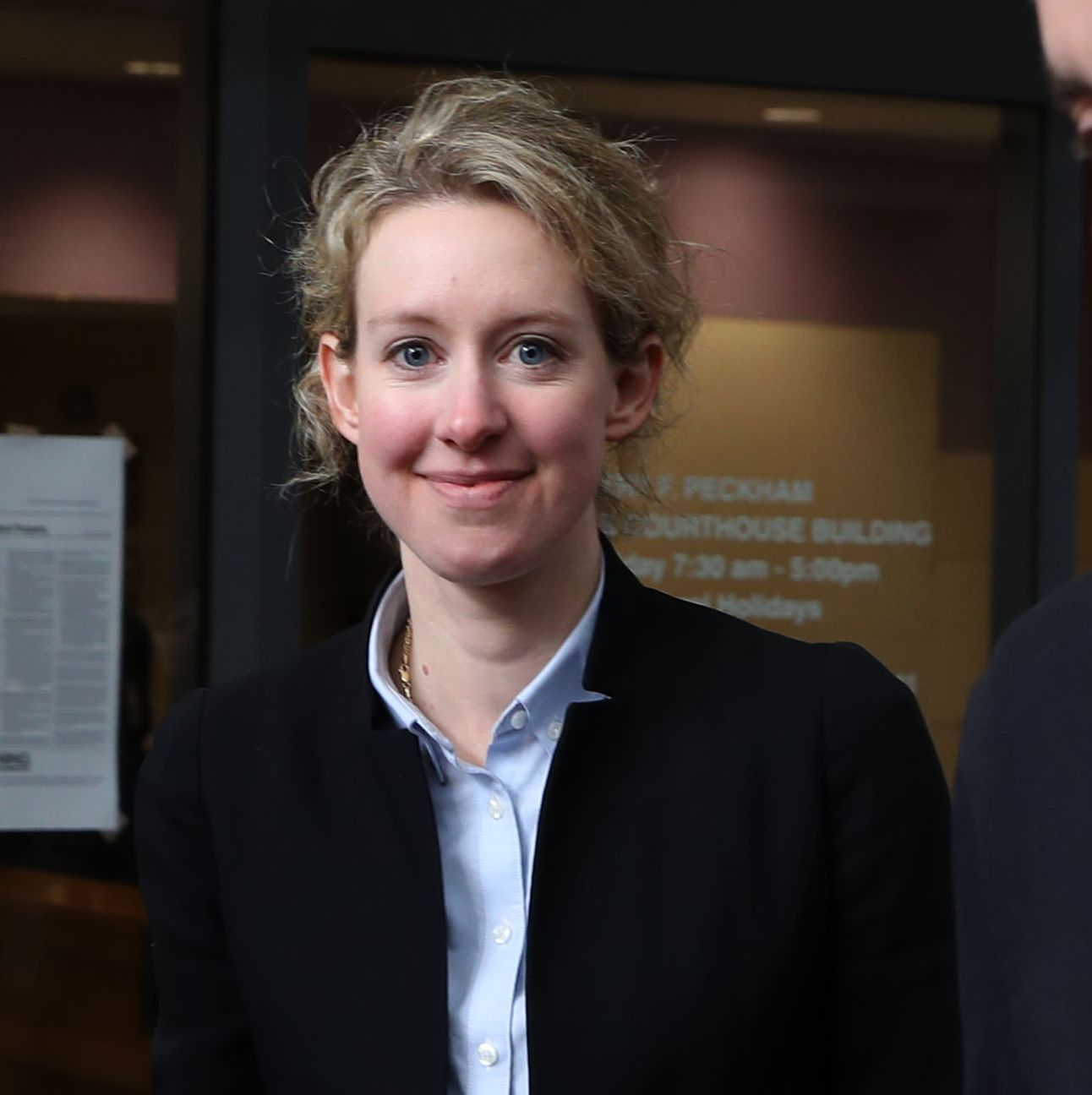 Today, Elizabeth Holmes Awaits Her Fraud Trial. But She Reportedly Remains 'Chipper.'