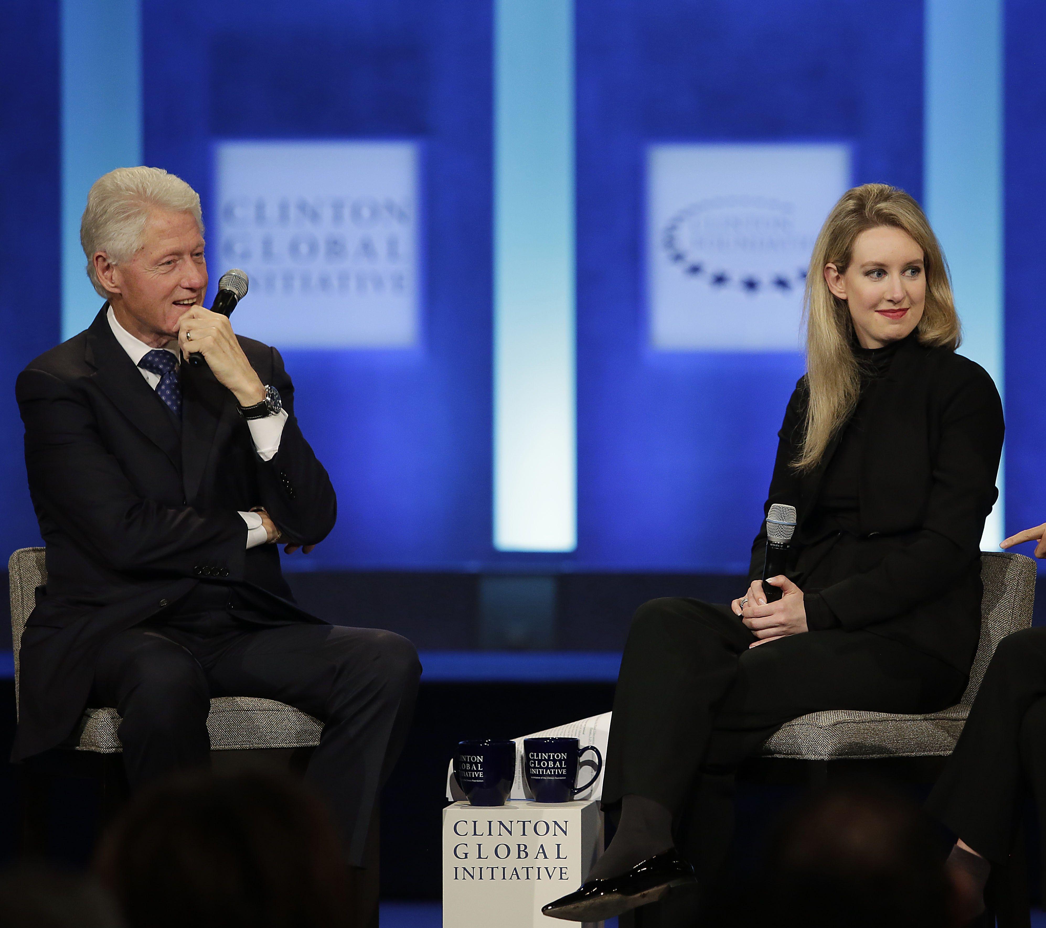 Elizabeth Holmes with Bill Clinton in 2015.