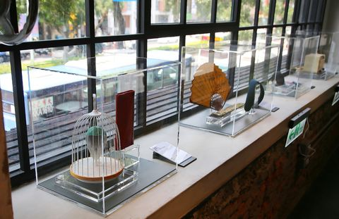 Glass, Building, Architecture, Room, Interior design, Window, Display case, Table, Transparent material, Coffeehouse,