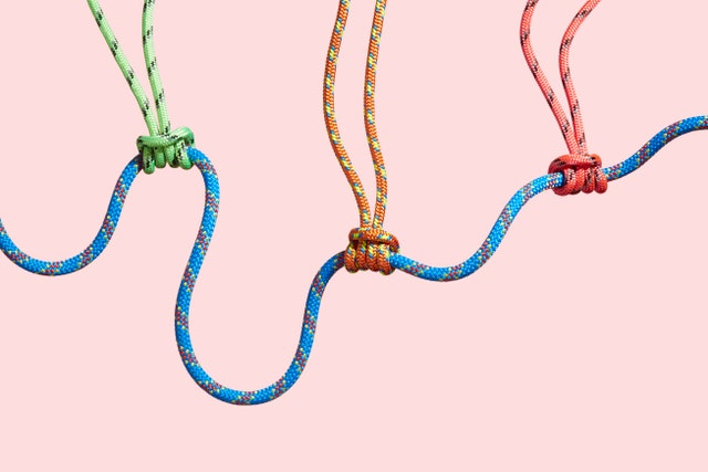 four coloured ropes supporting a larger rope