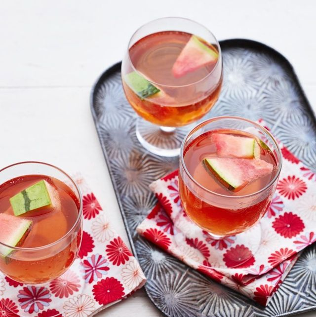 watermelon sangria three glasses with tray and napkins
