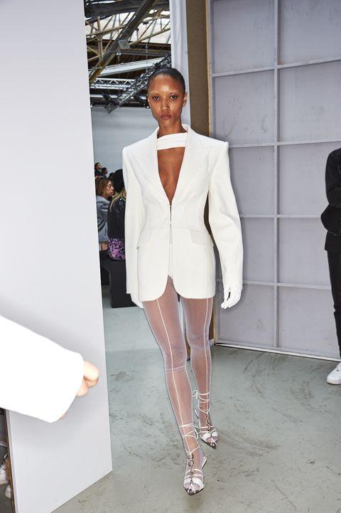 White, Fashion, Clothing, Blazer, Suit, Outerwear, Fashion model, Fashion design, Street fashion, Footwear,