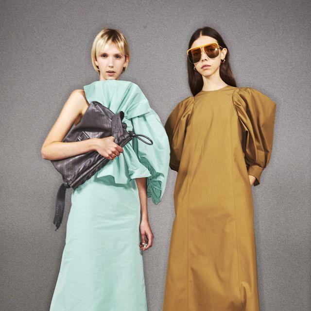 Clothing, Green, Fashion, Yellow, Shoulder, Fashion design, Dress, Outerwear, Joint, Fashion model,