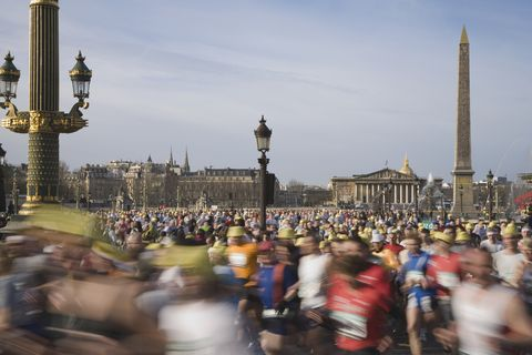 France, Paris, runners in Paris Marathon crossing Place de la Concorde