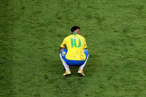Football player, Green, Football, Player, Grass, Soccer, Team sport, Yellow, Soccer player, Lawn,