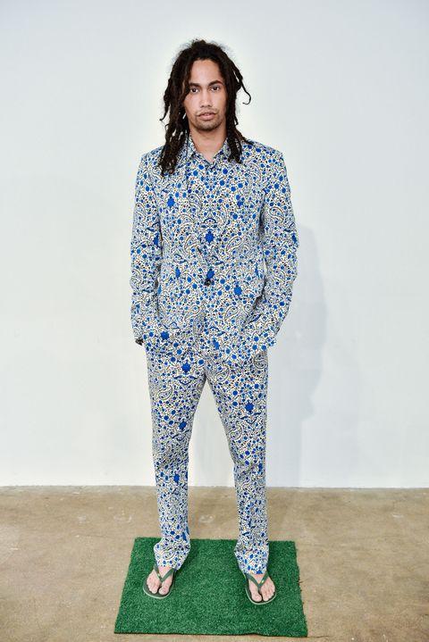 Clothing, Blue, Fashion, Pajamas, Outerwear, Electric blue, Visual arts, Trousers, Fashion design, Sportswear,