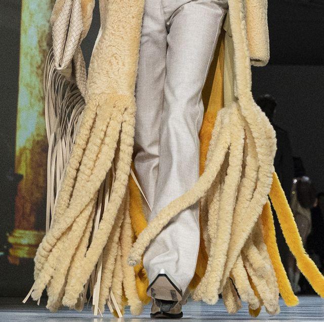 Yellow, Fashion, Performance art, Costume design, Fur, Performance, Art, Haute couture,