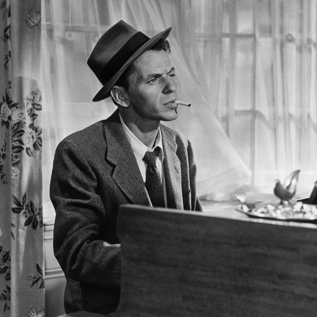 in a classic pose, frank sinatra smokes a cigarette as he plays piano in the movie young at heart one of the movies songs became a trademark saloon song for sinatra make it one for my baby and one more for the road, by harold arlen and johnny mercer