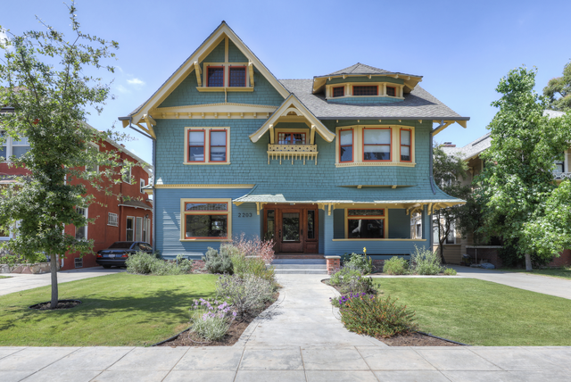 teal house with yellow and red accents