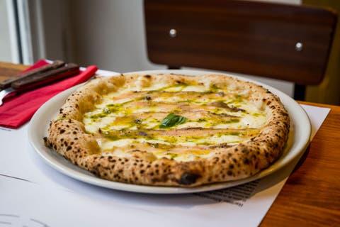 Dish, Food, Cuisine, Ingredient, Flatbread, Baked goods, Pizza cheese, Pizza, Manakish, Recipe,