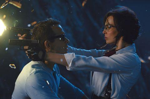 Ryan Reynolds as Guy and Jodie Comer as Molotov Girl