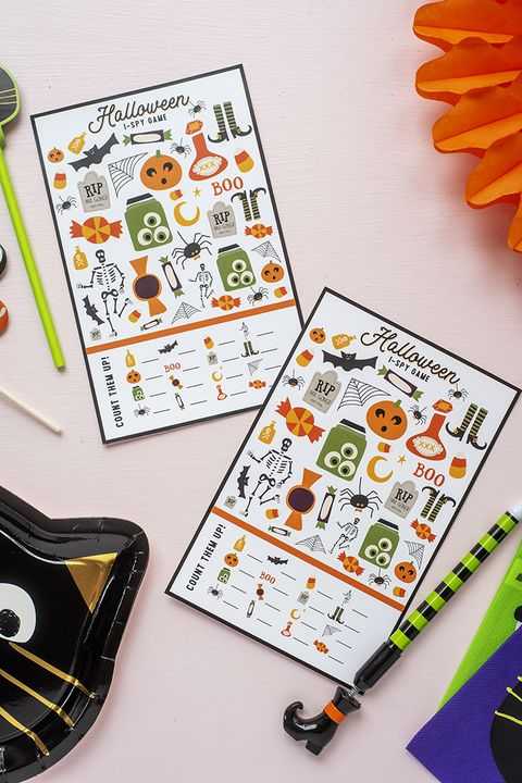 halloween i spy printable game board on table