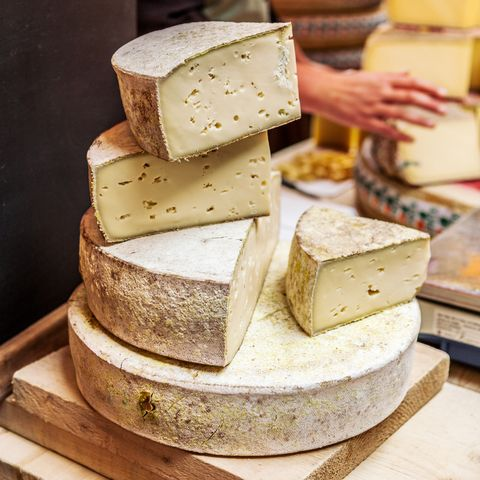 French cheeses on market stall