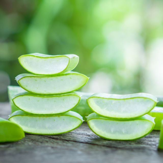 fresh aloe vera leaves slice and aloe vera gel on wooden table