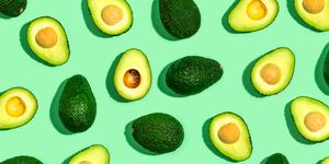 Fresh avocado pattern on a green background
