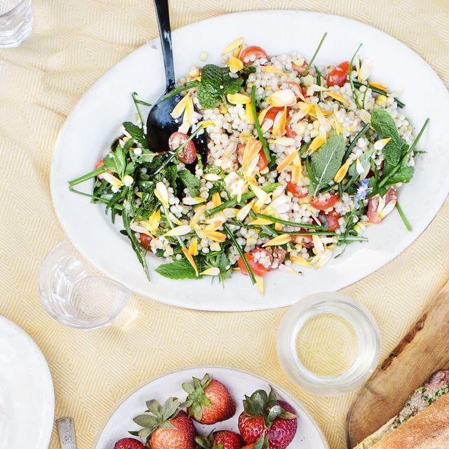 fresh corn, tomato, herb, and israeli couscous salad