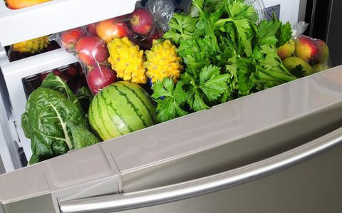 Fresh fruit and vegetables in salad draw of refrigerator