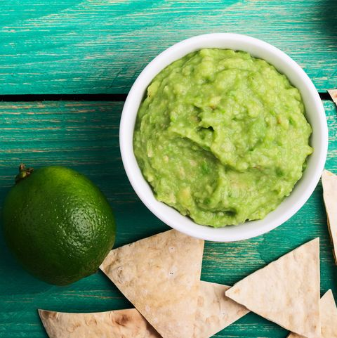 Fresh guacamole dip with lime juice and tortilla chips