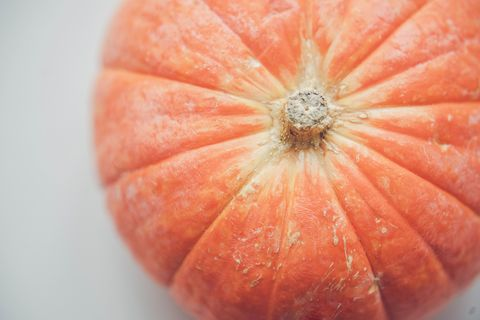Fresh orange pumpkin on white background.